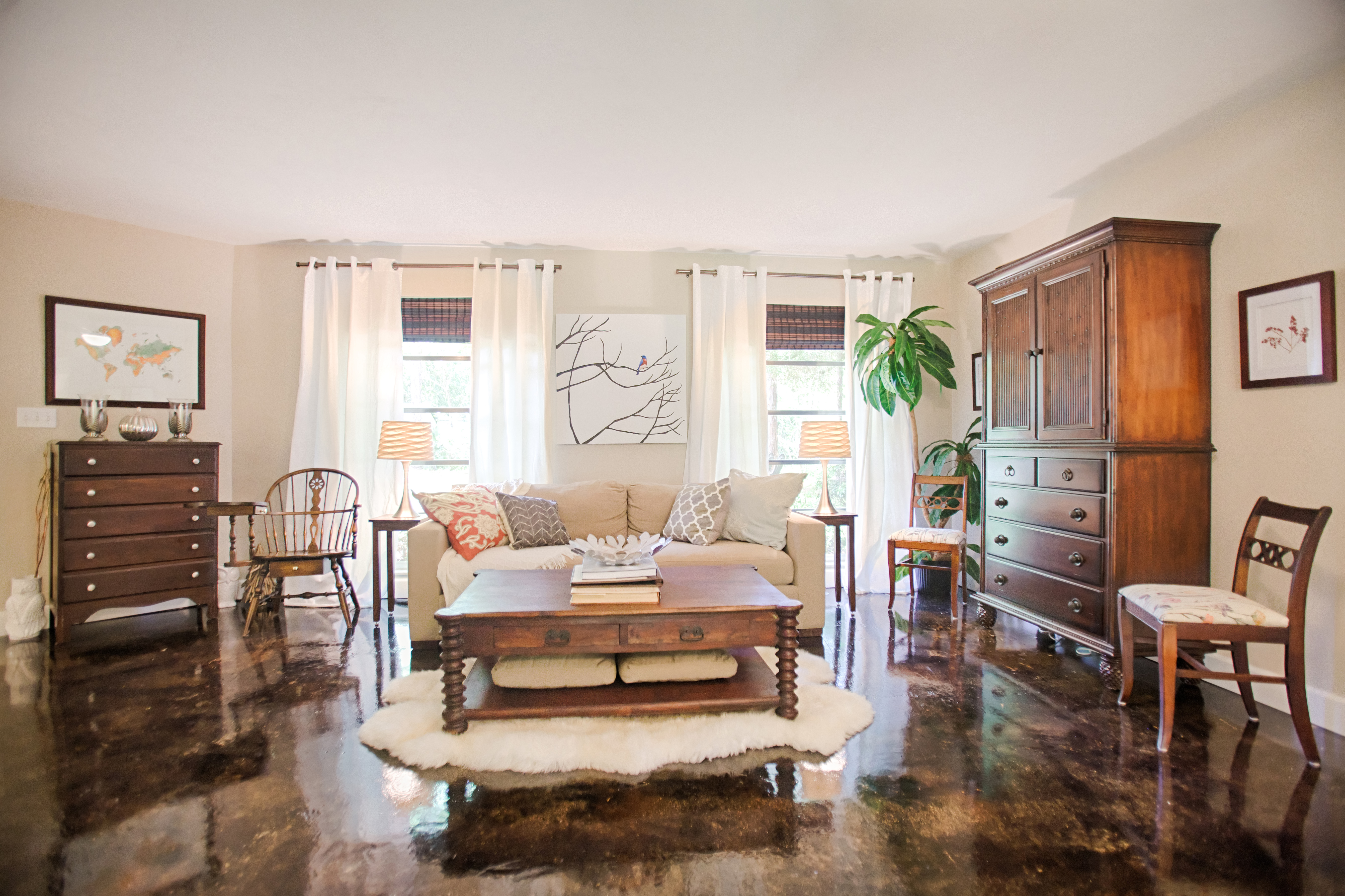 The living room, painted Benjamin Moore's Cedar Key, is decorated with secondhand furniture