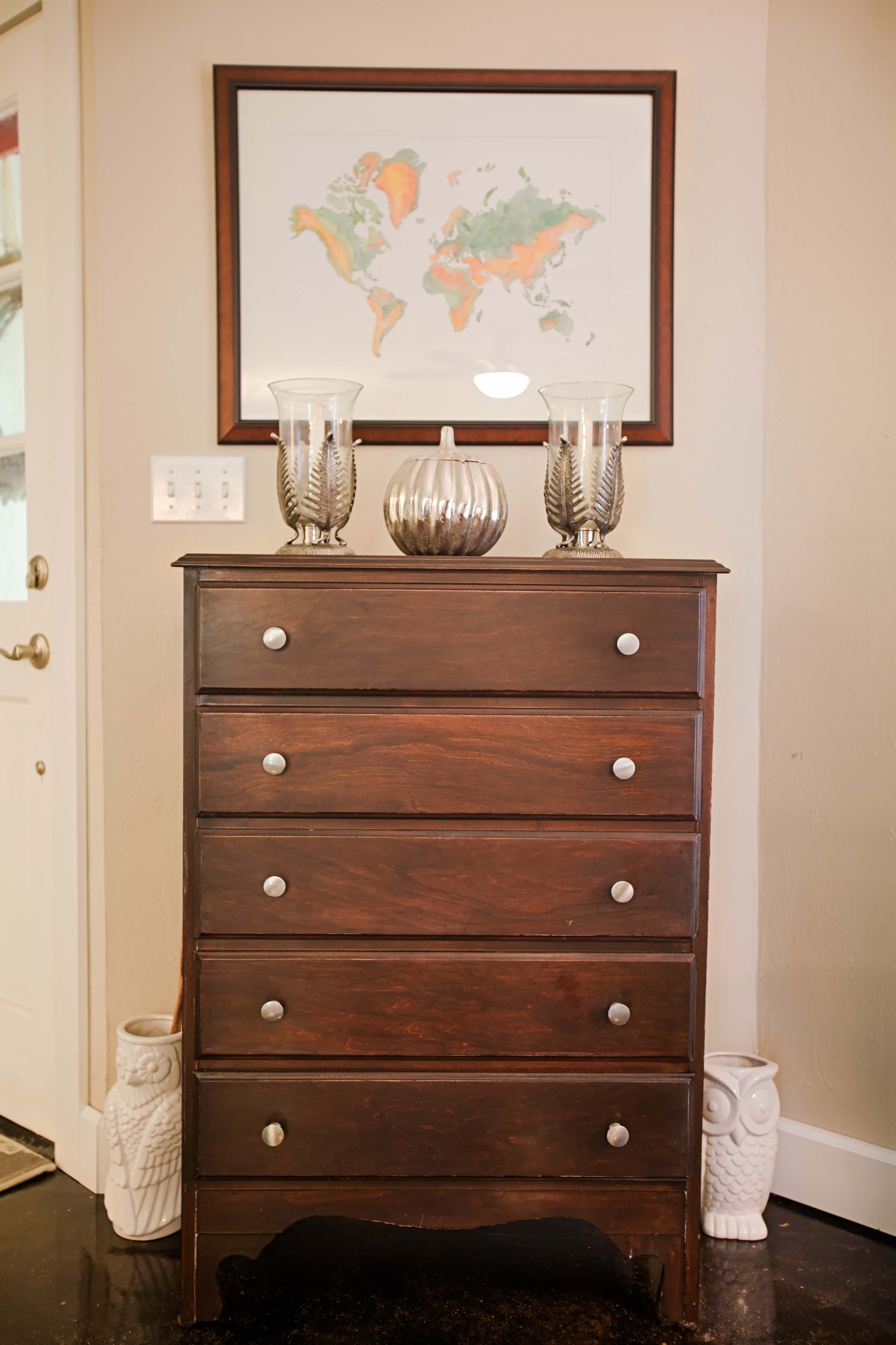 A family dresser was stripped and stained then used as a focal point in the living room