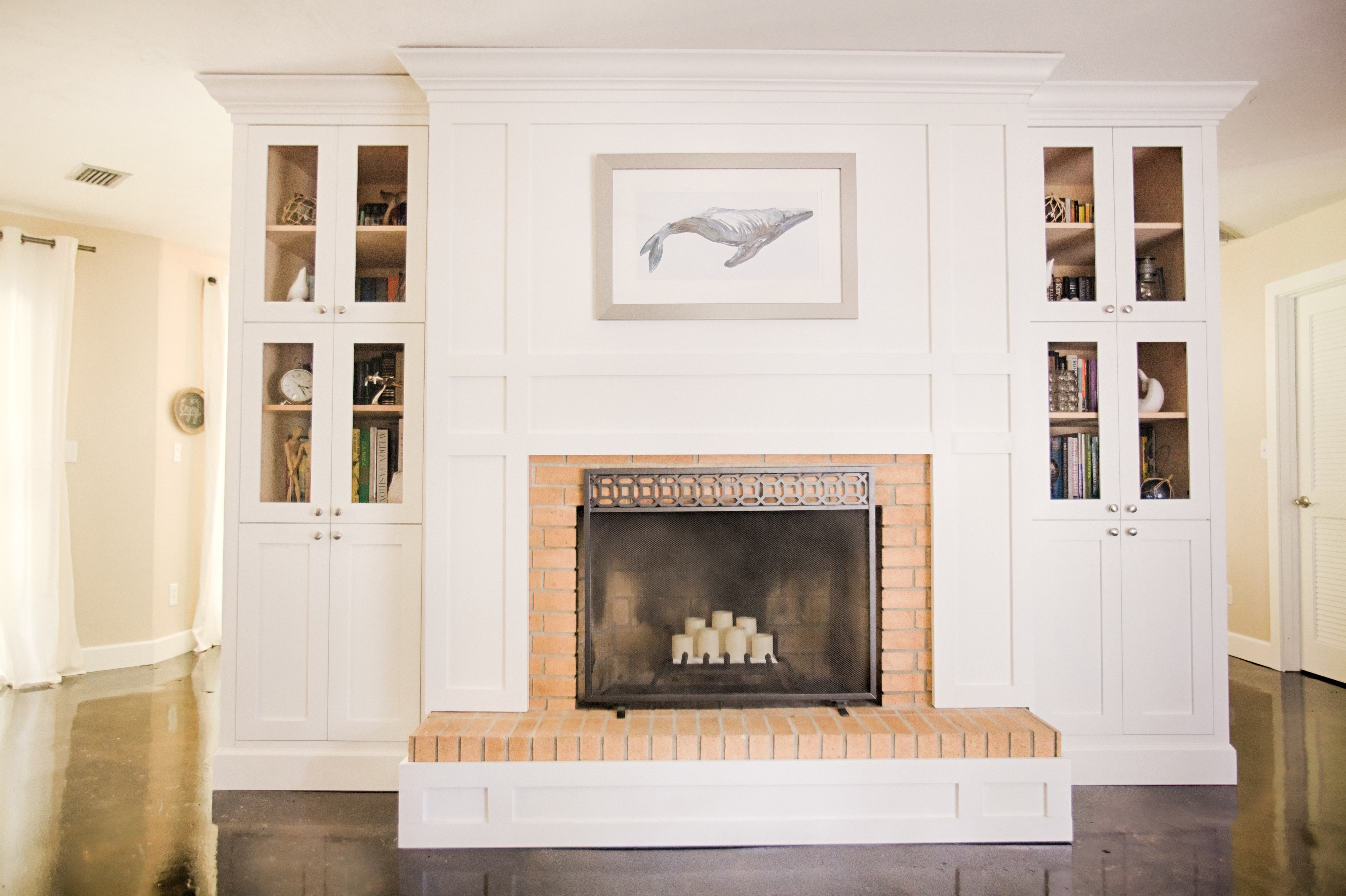 Built-in cabinets surrounding the fireplace finished with shaker trim