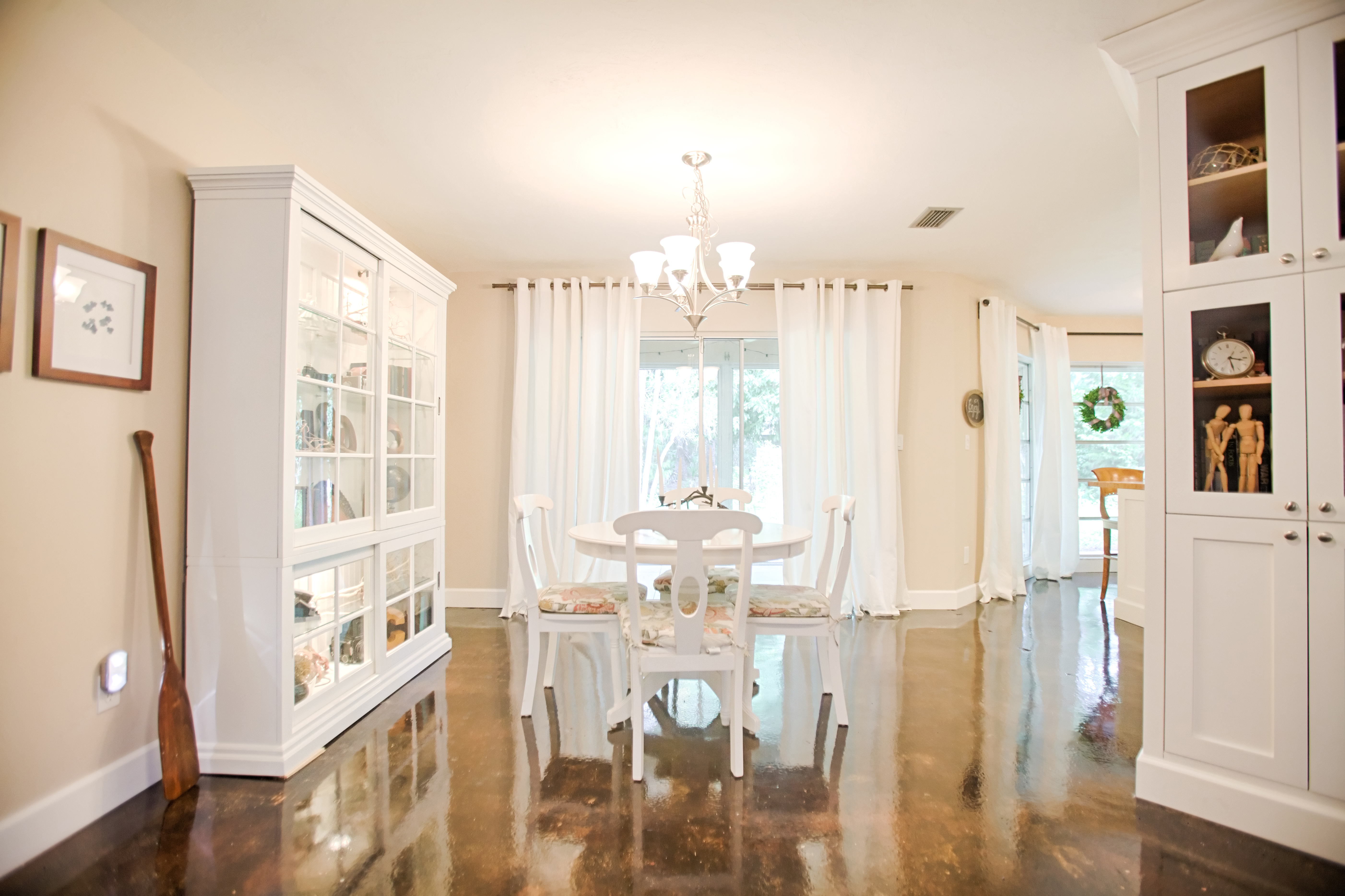 The dining room, painted Benjamin Moore's Cedar Key, is decorated with secondhand furniture
