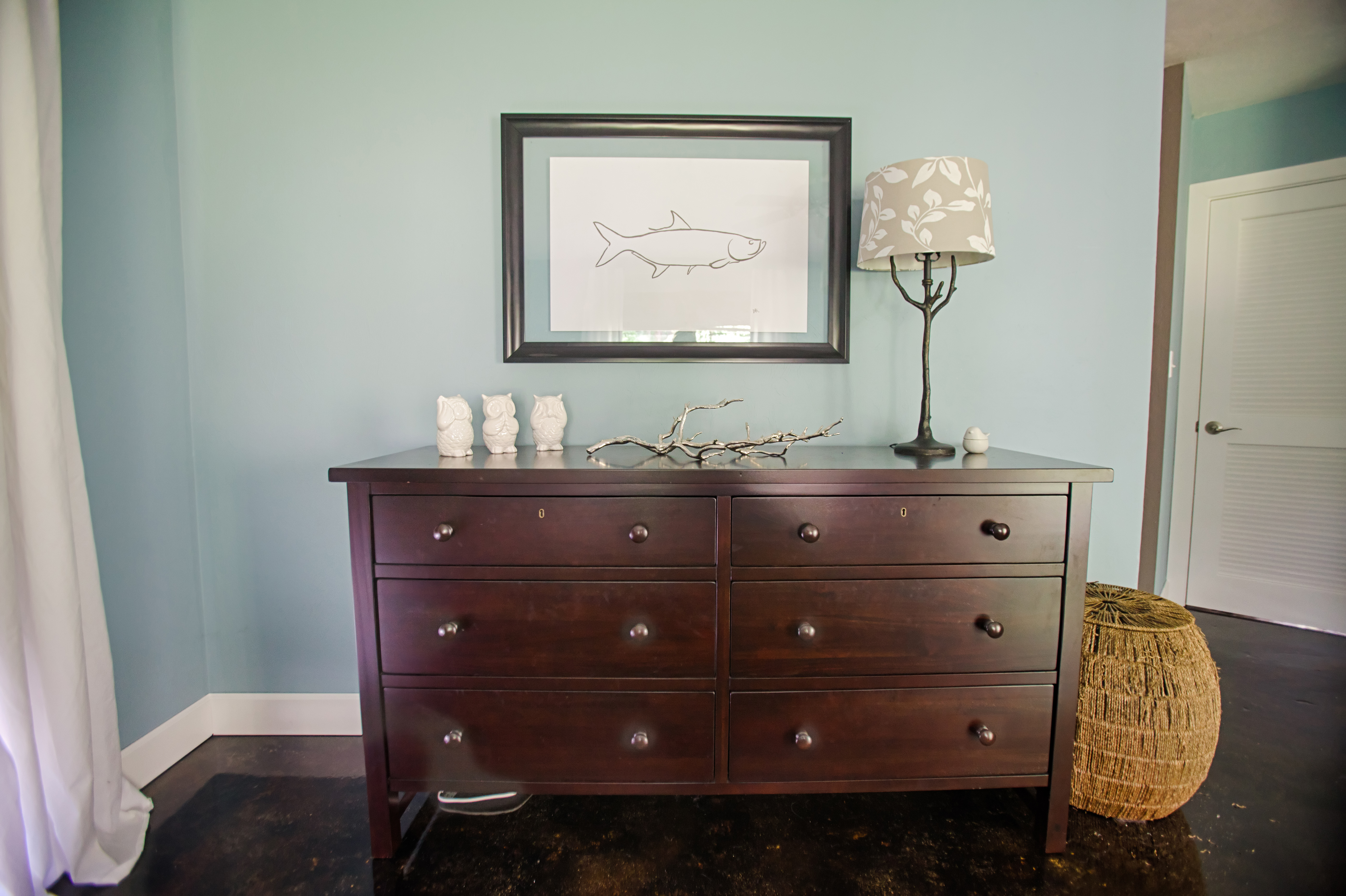 Secondhand furniture and homemade art make up most of the home decor